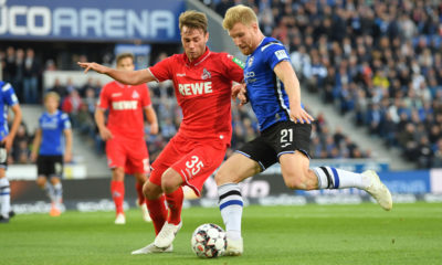 BIELEFELD, GERMANY - SEPTEMBER 28: Matthias Bader (L) of Koeln and Fabian Klos of Bielefeld fight for the ball during the Second Bundesliga match between DSC Arminia Bielefeld and 1. FC Koeln at Schueco Arena on September 28, 2018 in Bielefeld, Germany. (Photo by Thomas Starke/Bongarts/Getty Images)