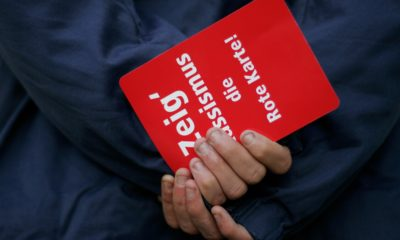 HANOVER, GERMANY - OCTOBER 21: Fans show a red card against racism during the Bundesliga match between Hanover 96 and VfL Wolfsburg at the AWD Arena on October 21, 2007 in Hanover, Germany. (Photo by Friedemann Vogel/Bongarts/Getty Images)