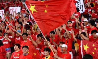 BRISBANE, AUSTRALIA - JANUARY 14: Chinese fans show their support during the 2015 Asian Cup match between China PR and Uzbekistan at Suncorp Stadium on January 14, 2015 in Brisbane, Australia. (Photo by Bradley Kanaris/Getty Images)