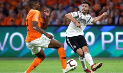 AMSTERDAM, NETHERLANDS - OCTOBER 13: Jonas Hector of Germany (R) is challenged by Denzel Dumfries of the Netherlands during the UEFA Nations League A group one match between Netherlands and Germany at Johan Cruyff Arena on October 13, 2018 in Amsterdam, Netherlands. (Photo by Alex Grimm/Bongarts/Getty Images)