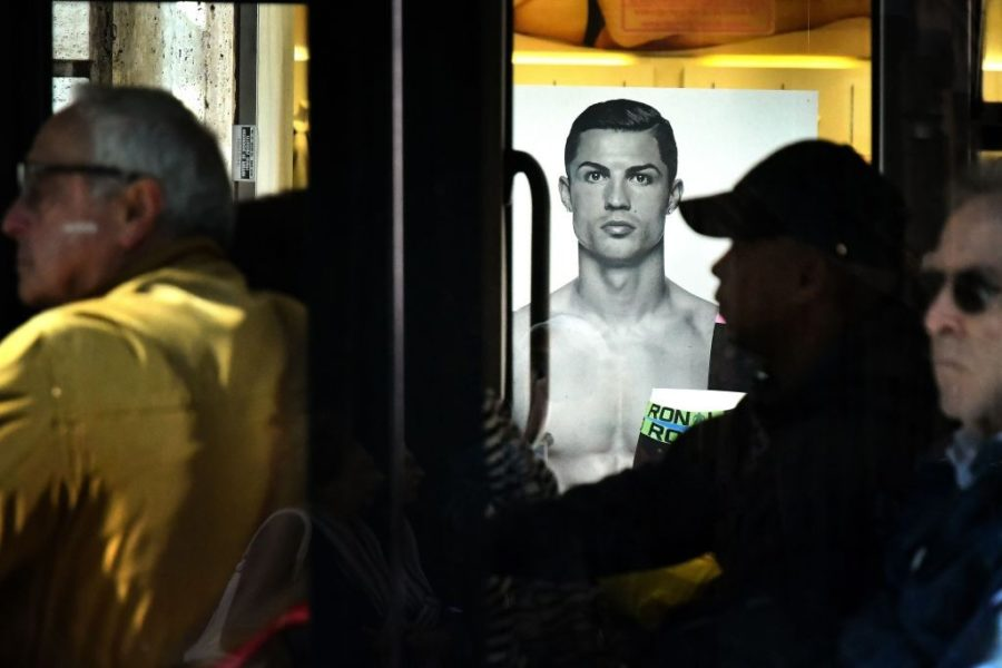 A passenger bus drives past an advertising poster for an underwear brand, showing a picture of Juventus' Portuguese forward Cristiano Ronaldo, on October 9, 2018 in downtown Rome. - Cristiano Ronaldo faces rape allegations after US police on October 1, 2018 re-opened an investigation into claims by former American model Kathryn Mayorga that the five-time Ballon d'Or winner raped her in a Las Vegas hotel in June 2009. (Photo by Alberto PIZZOLI / AFP) (Photo credit should read ALBERTO PIZZOLI/AFP/Getty Images)
