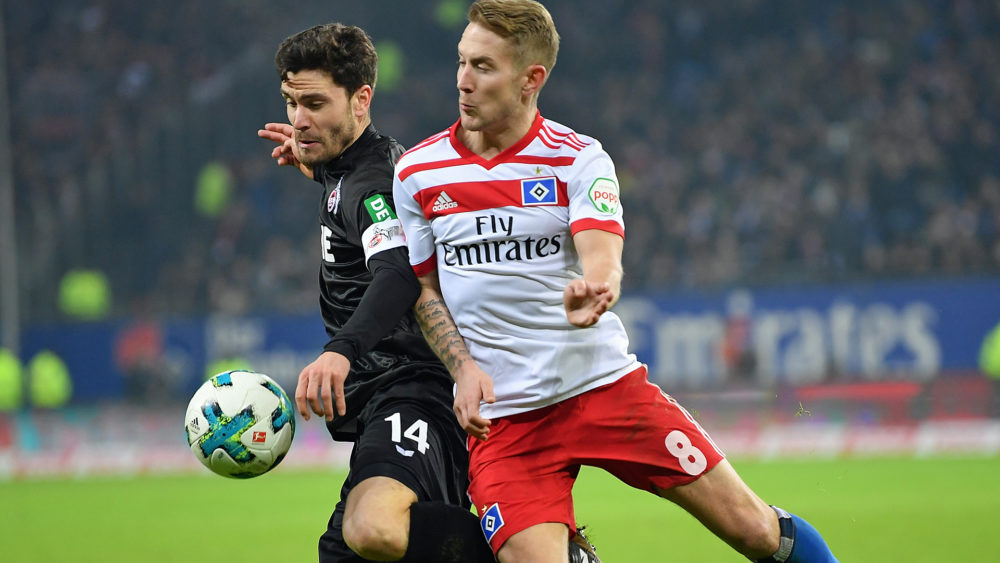 HAMBURG, GERMANY - JANUARY 20: Lewis Holtby of Hamburg is challenged by Jonas Hector of Cologne during the Bundesliga match between Hamburger SV and 1. FC Koeln at Volksparkstadion on January 20, 2018 in Hamburg, Germany. (Photo by Stuart Franklin/Bongarts/Getty Images)