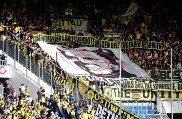 SINSHEIM, GERMANY - SEPTEMBER 22: Borussia Dortmund fans show their support during the Bundesliga match between TSG 1899 Hoffenheim and Borussia Dortmund at Wirsol Rhein-Neckar-Arena on September 22, 2018 in Sinsheim, Germany. (Photo by Alex Grimm/Bongarts/Getty Images)