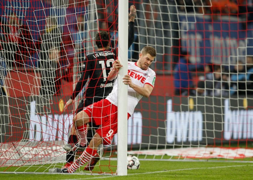 COLOGNE, GERMANY - DECEMBER 17: Simon Terodde of Cologne scores the 3:0 goal during the Second Bundesliga match between 1. FC Koeln and 1. FC Magdeburg at RheinEnergieStadion on December 17, 2018 in Cologne, Germany. (Photo by Mika Volkmann/Bongarts/Getty Images)