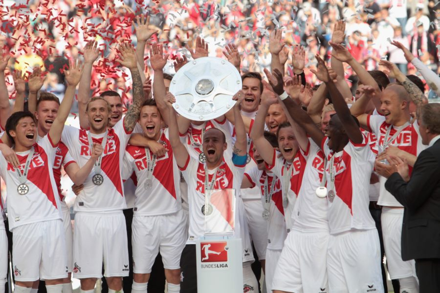 COLOGNE, GERMANY - MAY 04: Team captain Miso Brecko of Cologne lifts the trophy after winning the championship title of the Second Bundesliga at RheinEnergieStadion on May 4, 2014 in Cologne, Germany. (Photo by Juergen Schwarz/Bongarts/Getty Images)