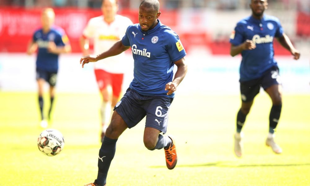 REGENSBURG, GERMANY - AUGUST 26: David Kinsombi of Holstein Kiel controls the ball during the Second Bundesliga match between SSV Jahn Regensburg and Holstein Kiel at Continental Arena on August 26, 2018 in Regensburg, Germany. (Photo by Adam Pretty/Bongarts/Getty Images)