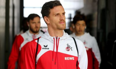 SINSHEIM, GERMANY - MARCH 31: Simon Zoller of Koeln walks out of the bus prior to the Bundesliga match between TSG 1899 Hoffenheim and 1. FC Koeln at Wirsol Rhein-Neckar-Arena on March 31, 2018 in Sinsheim, Germany.