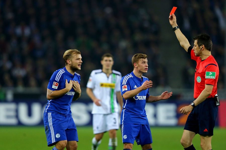 MOENCHENGLADBACH, GERMANY - OCTOBER 25: Referee Wolfgang Stark (R) shows Johannes Geis of Schalke (L) the red card during the Bundesliga match between Borussia Moenchengladbach and FC Schalke 04 at Borussia-Park on October 25, 2015 in Moenchengladbach, Germany. (Photo by Christof Koepsel/Bongarts/Getty Images)