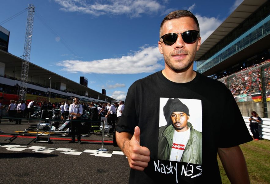 SUZUKA, JAPAN - OCTOBER 07: German football player Lukas Podolski poses for a photo on the grid before the Formula One Grand Prix of Japan at Suzuka Circuit on October 7, 2018 in Suzuka. (Photo by Mark Thompson/Getty Images)