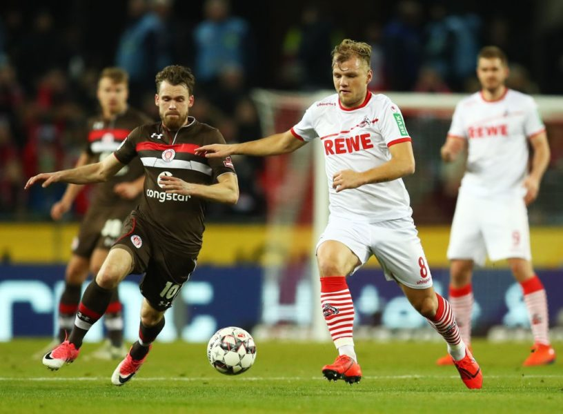 COLOGNE, GERMANY - FEBRUARY 08: Christopher Buchtmann of FC St. Pauli battles with Johannes Geis of FC Koln during the Second Bundesliga match between 1. FC Koeln and FC St. Pauli at RheinEnergieStadion on February 08, 2019 in Cologne, Germany. (Photo by Maja Hitij/Bongarts/Getty Images)