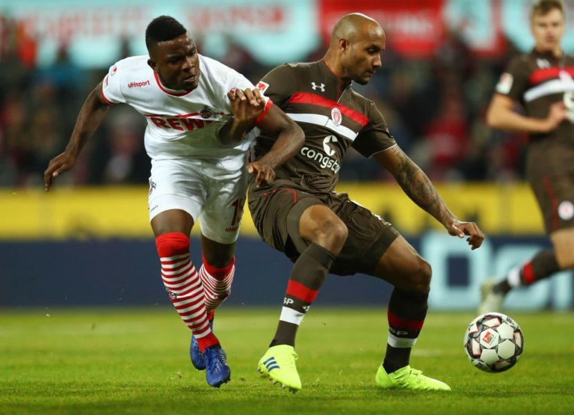 COLOGNE, GERMANY - FEBRUARY 08: Christopher Avevor of FC St. Pauli holds off Jhon Cordoba of FC Koln during the Second Bundesliga match between 1. FC Koeln and FC St. Pauli at RheinEnergieStadion on February 08, 2019 in Cologne, Germany. (Photo by Maja Hitij/Bongarts/Getty Images)