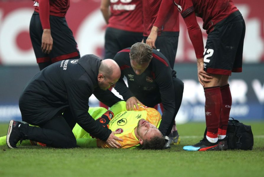 NUREMBERG, GERMANY - FEBRUARY 02: Christian Mathenia of FC Nuernberg receives medical treatment during the Bundesliga match between 1. FC Nuernberg and SV Werder Bremen at Max-Morlock-Stadion on February 2, 2019 in Nuremberg, Germany. (Photo by Adam Pretty/Bongarts/Getty Images)