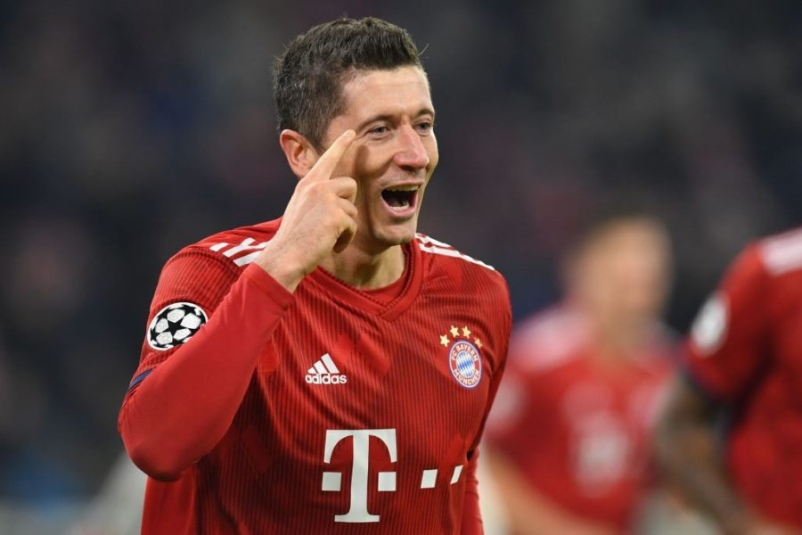 Bayern Munich's Polish forward Robert Lewandowski celebrates after scoring the 4-1 goal during the UEFA Champions League Group E football match between Bayern Munich and Benfica Lisbon in Munich, southern Germany, on November 27, 2018. (Photo by Christof STACHE / AFP) (Photo credit should read CHRISTOF STACHE/AFP/Getty Images)