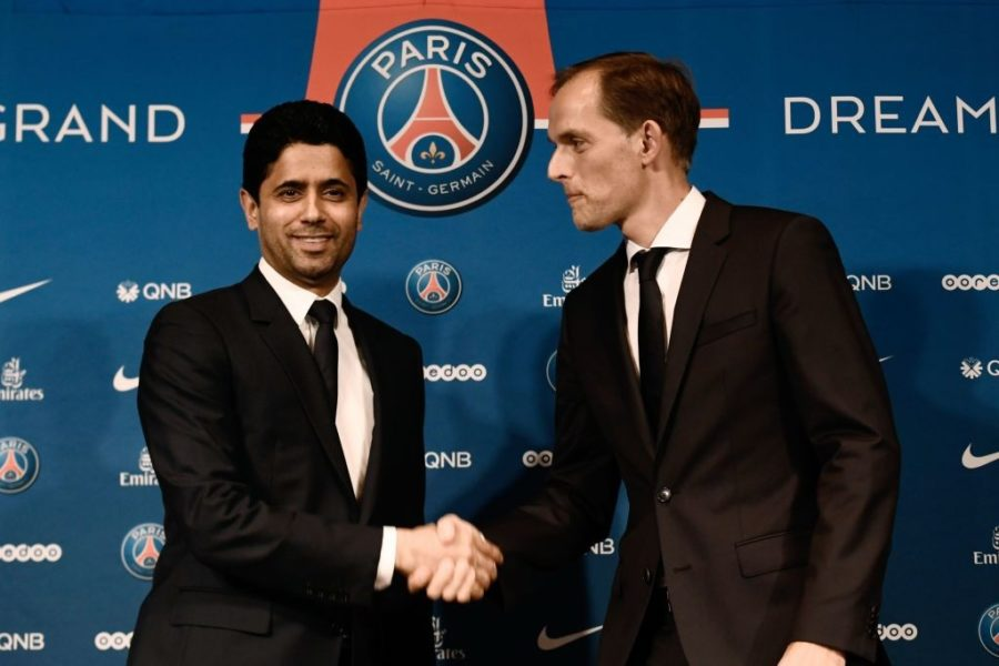 French Ligue 1 football club Paris Saint-Germain's newly appointed coach German Thomas Tuchel (R) shakes hand with club's president Nasser Al-Khelaifi at the end of a press conference to officially present him as the club's new recruit on May 20, 2018 at the Parc des Princes stadium in Paris