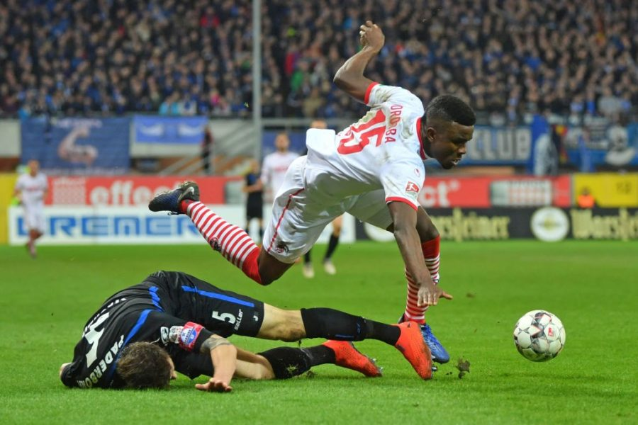 PADERBORN, GERMANY - FEBRUARY 15: Christian Strohdiek (L) of Paderborn tackles Jhon Cordoba of Koeln during the Second Bundesliga match between SC Paderborn 07 and 1. FC Koeln at Benteler Arena on February 15, 2019 in Paderborn, Germany. (Photo by Thomas F. Starke/Bongarts/Getty Images)