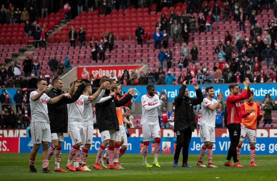 COLOGNE, GERMANY - MARCH 09: Players celebrate with fans after winning the Second Bundesliga match between 1. FC Koeln and DSC Arminia Bielefeld at RheinEnergieStadion on March 09, 2019 in Cologne, Germany. (Photo by Maja Hitij/Bongarts/Getty Images)