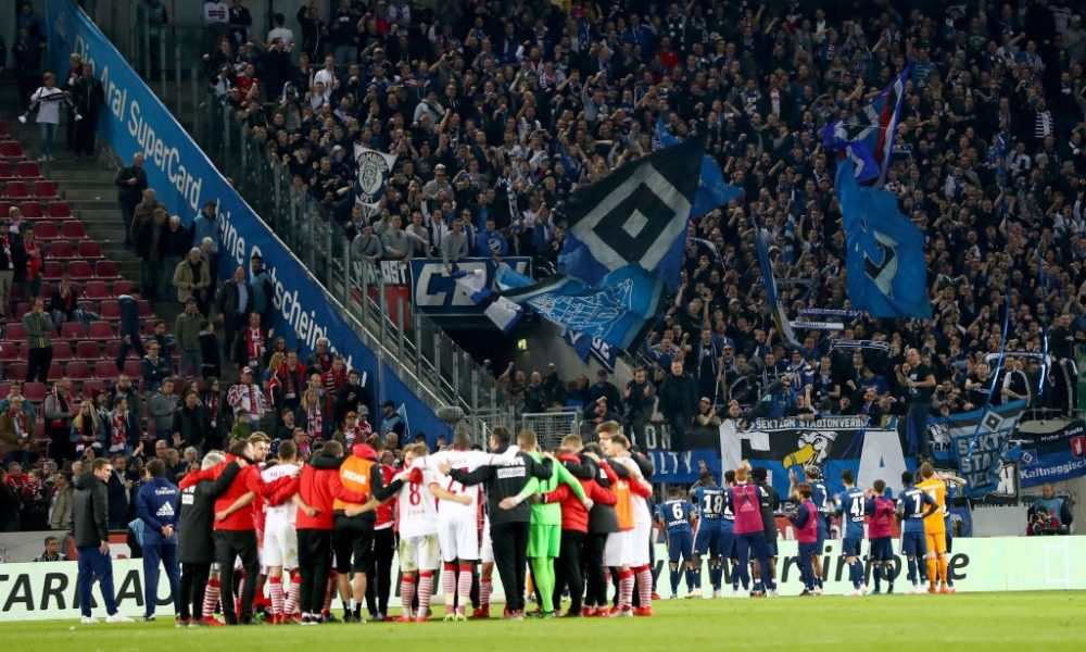 COLOGNE, GERMANY - APRIL 15: Team members of Hamburg celebrate with their fans after the Second Bundesliga match between 1. FC Koeln and Hamburger SV at RheinEnergieStadion on April 15, 2019 in Cologne, Germany. (Photo by Lars Baron/Bongarts/Getty Images)