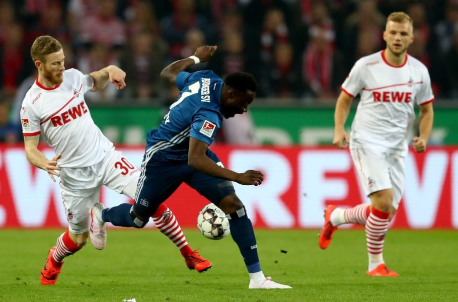 COLOGNE, GERMANY - APRIL 15: Florian Kainz (L) of Koeln challenges Khaled Narey of Hamburg during the Second Bundesliga match between 1. FC Koeln and Hamburger SV at RheinEnergieStadion on April 15, 2019 in Cologne, Germany. (Photo by Lars Baron/Bongarts/Getty Images)