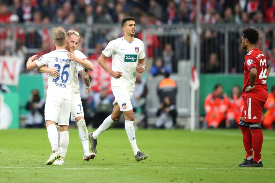 MUNICH, GERMANY - APRIL 03: Marc Schnatterer of Heidenheim celebrates his team's second goal with team mate Niklas Dorsch during the DFB Cup quarterfinal match between Bayern Muenchen and 1. FC Heidenheim at Allianz Arena on April 03, 2019 in Munich, Germany. (Photo by Adam Pretty/Bongarts/Getty Images)