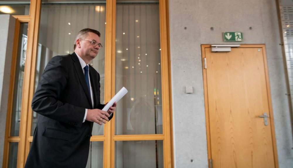 FRANKFURT AM MAIN, GERMANY - APRIL 02: Reinhard Grindel, President of the German Football Association (DFB), leaves a press conference at DFB Headquarter on April 02, 2019 in Frankfurt am Main, Germany. Grindel has stepped down as president, effective immediately. This was confirmed by the DFB today after German media reported on financial irregularities. The two vice presidents Rainer Koch and Reinhard Rauball will take over the leadership of the association on an interim basis until the DFB Bundestag in September. (Photo by Alexander Scheuber/Bongarts/Getty Images)