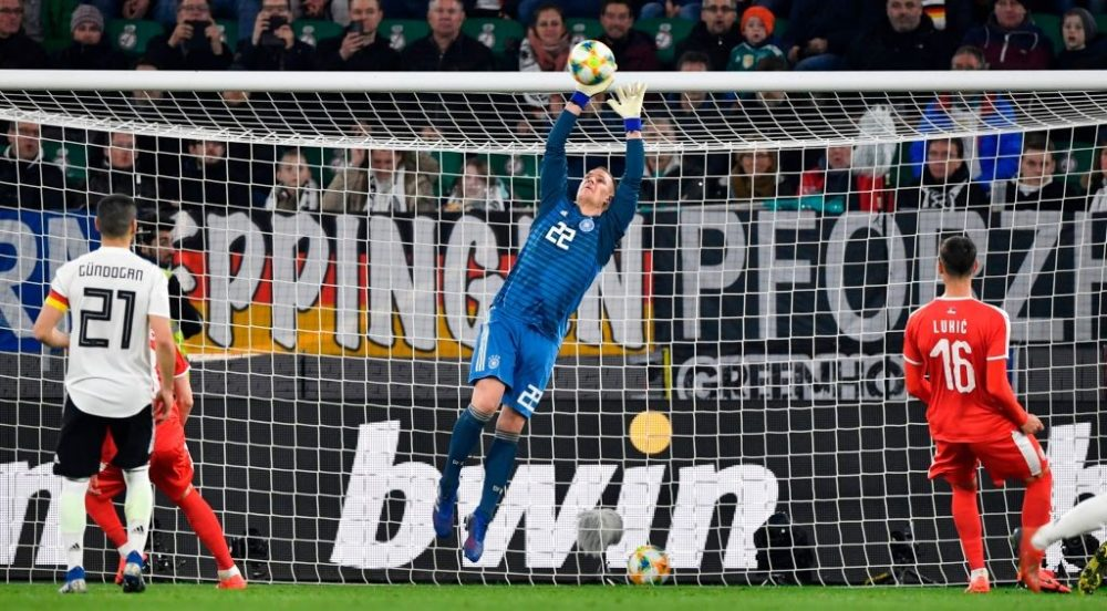 Germany's goalkeeper Marc-Andre ter Stegen makes a save during the friendly football match Germany v Serbia in Wolfsburg, western Germany on March 20, 2019. (Photo by John MACDOUGALL / AFP) / RESTRICTIONS: ACCORDING TO DFB RULES IMAGE SEQUENCES TO SIMULATE VIDEO IS NOT ALLOWED DURING MATCH TIME. MOBILE (MMS) USE IS NOT ALLOWED DURING AND FOR FURTHER TWO HOURS AFTER THE MATCH. == RESTRICTED TO EDITORIAL USE == FOR MORE INFORMATION CONTACT DFB DIRECTLY AT +49 69 67880 / (Photo credit should read JOHN MACDOUGALL/AFP/Getty Images)