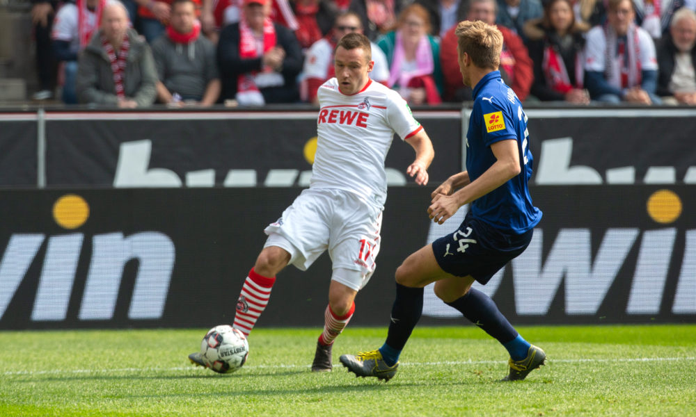 COLOGNE, GERMANY - MARCH 31: Christian Clemens of Cologne (L) and Hauke Wahl of Kiel battle for the ball during the Second Bundesliga match between 1. FC Koeln and Holstein Kiel at RheinEnergieStadion on March 31, 2019 in Cologne, Germany. (Photo by Juergen Schwarz/Bongarts/Getty Images)