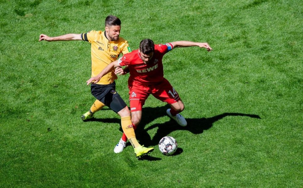 DRESDEN, GERMANY - APRIL 21: Niklas Kreuzer (L) of Dresden is challenged by Jonas Hector of Koeln during the Second Bundesliga match between SG Dynamo Dresden and 1. FC Koeln at Rudolf-Harbig-Stadion on April 21, 2019 in Dresden, Germany. (Photo by Thomas Eisenhuth/Bongarts/Getty Images)