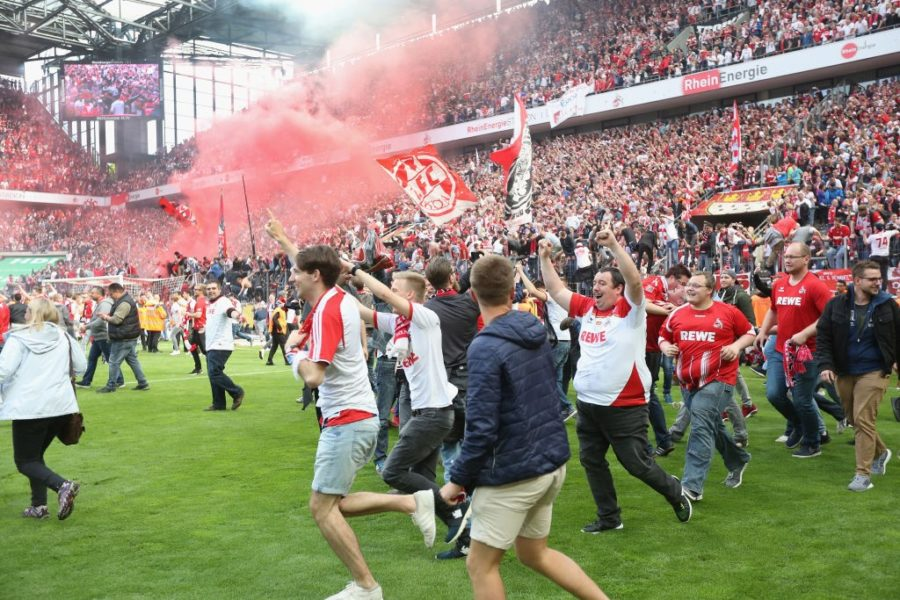 COLOGNE, GERMANY - MAY 20: Supporters of Cologne run on the pitch after the Bundesliga match between 1. FC Koeln and 1. FSV Mainz 05 at RheinEnergieStadion on May 20, 2017 in Cologne, Germany. Cologne will play Europe League next season. (Photo by Juergen Schwarz/Bongarts/Getty Images)