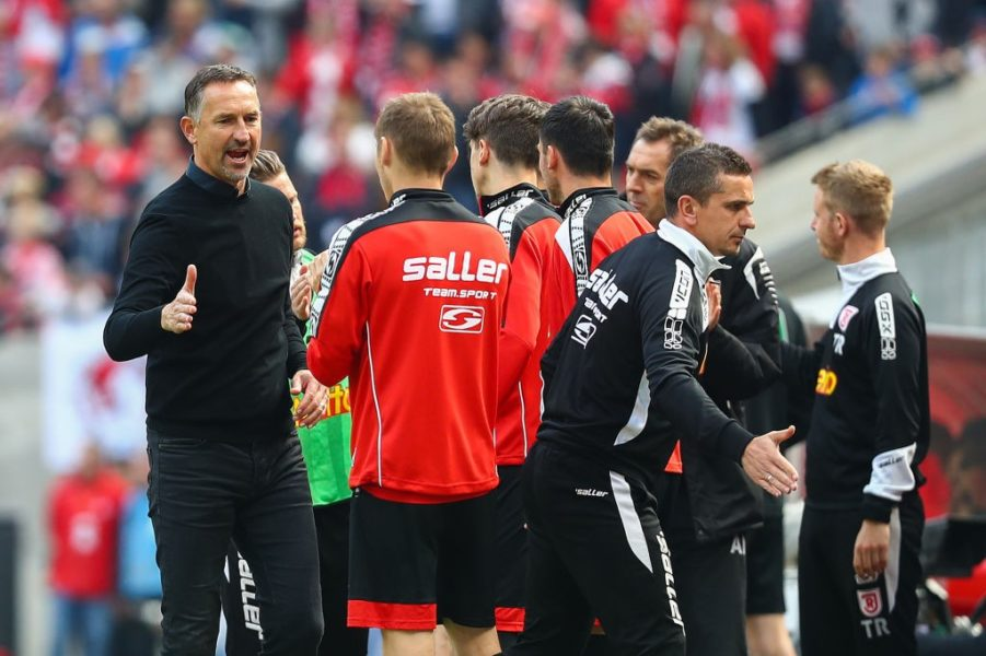 COLOGNE, GERMANY - MAY 12: Head Coach Achim Beierlorzer of SSV Jahn Regensburg celebrates with his players after Sargis Adamyan of SSV Jahn Regensburg (not in picture) scored his team's second goal during the Second Bundesliga match between 1. FC Koeln and SSV Jahn Regensburg at RheinEnergieStadion on May 12, 2019 in Cologne, Germany. (Photo by Lars Baron/Bongarts/Getty Images)