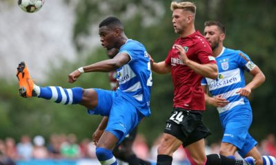 ILTEN, GERMANY - JULY 21: Kingsley Ehizibue of PEC Zwolle (L) and Niclas Fuellkrug of Hannover battle for the ball during the preseason friendly match between Hannover 96 and PEC Zwolle at Wahre Dorff Arena on July 21, 2018 in Ilten, Germany. (Photo by Cathrin Mueller/Bongarts/Getty Images)