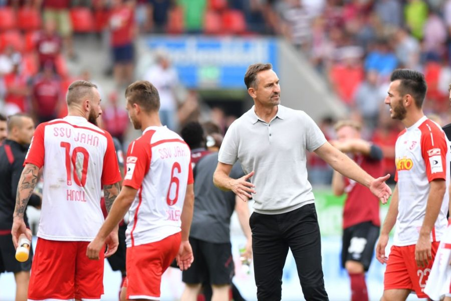 REGENSBURG, GERMANY - AUGUST 06: Head coach Achim Beierlorzer of SSV Jahn Regensburg talks to his players after the Second Bundesliga match between SSV Jahn Regensburg and 1. FC Nuernberg at Continental Arena on August 6, 2017 in Regensburg, Germany. (Photo by Sebastian Widmann/Bongarts/Getty Images)