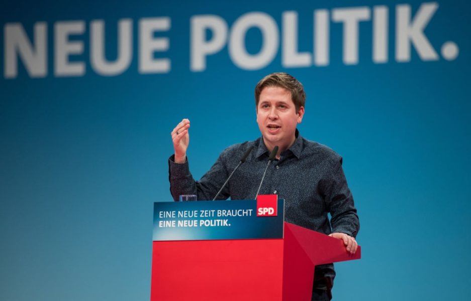 BONN, GERMANY - JANUARY 21: Kevin Kuehnert, leader of Germany's social democratic SPD party's youth organisation 'Jusos', speaks to delegates at the SPD federal congress on January 21, 2018 in Bonn, Germany. The SPD is holding the congress to decide on whether to join the German Christian Democrats (CDU/CSU) in a new German coalition government. Recent preliminary talks between the SPD, the CDU and the CSU finished with enough support from party leaderships to launch negotiations, though the SPD still needs the approval of its party base. Many SPD members have warned against the coalition and would rather see the party remain in the opposition. (Photo by Lukas Schulze/Getty Images)
