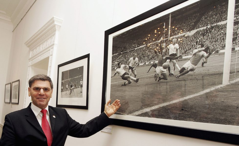 LONDON - MARCH 21: Former footballer Wolfgang Weber, who played in the 1966 World Cup final, points him self out in a picture from the game at the Heroes '66 Reception as part of a series of events hosted by the German Embassy commemorating 40 years since England won the Jules Rimet trophy, at The German Ambassador's residence, Belgrave Square on March 21, 2006 in London, England. (Photo by Bruno Vincent/Getty Images)