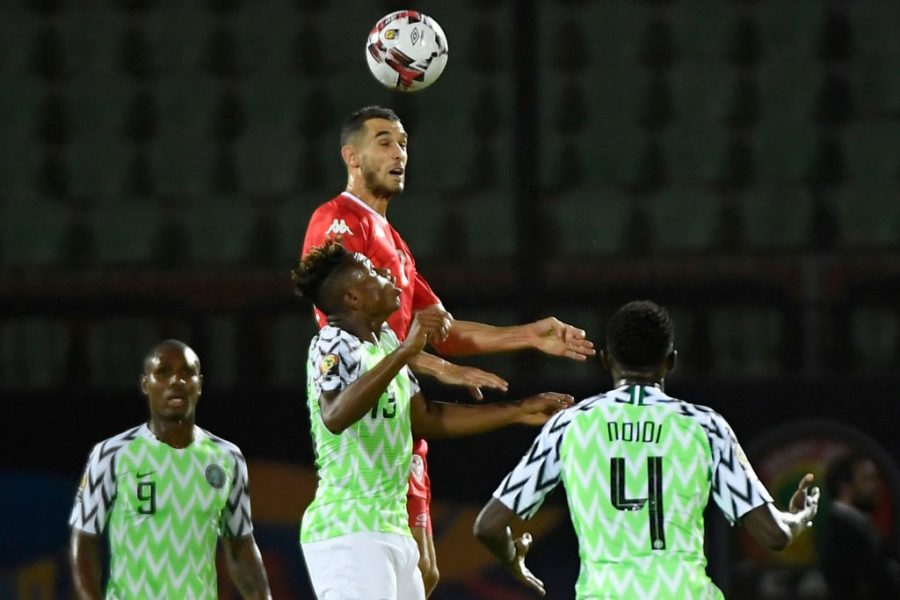 Tunisia's midfielder Ellyes Skhiri (top-C) heads the ball over Nigeria's forward Samuel Chukwueze (bottom-) during the 2019 Africa Cup of Nations (CAN) third place play-off football match between Tunisia and Nigeria at the Al Salam stadium in Cairo on July 17, 2019. (Photo by Khaled DESOUKI / AFP) (Photo credit should read KHALED DESOUKI/AFP/Getty Images)