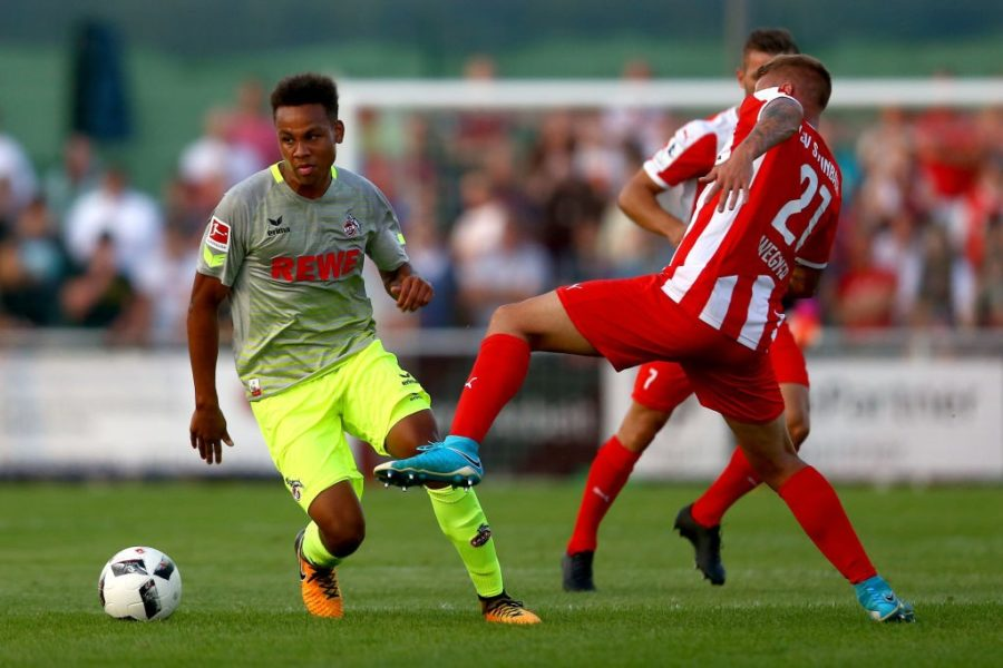 HAIGER, GERMANY - AUGUST 07: Dennis Wegner of Steinbach (R) challenges Nikolas Nartey of Kln (L) during the preseason friendly match between TSV Steinbach and 1. FC Koeln at Sibre-Sportzentrum Haarwasen on August 7, 2017 in Haiger, Germany. The match between Steinbach and Koeln ended 1-1. (Photo by Christof Koepsel/Bongarts/Getty Images)