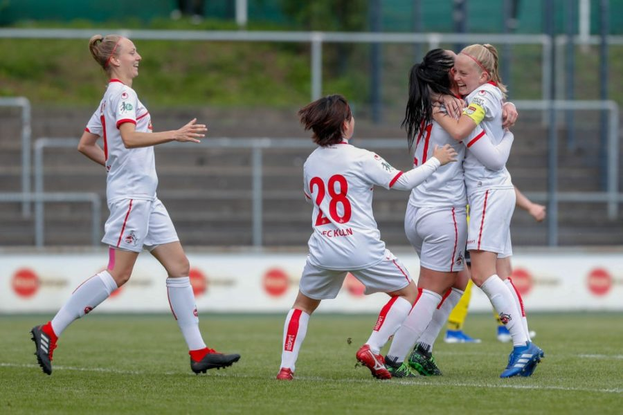 COLOGNE, GERMANY - MAY 12: Anna Isabelle Linden, Yuka Hirano, and Peggy Nietgen and Anna Kirschbaum of Koeln celebrate their goal during the women's second Bundesliga match between 1.FC Koeln and 1.FC Saarbruecken at Franz-Kremer Stadion on May 12, 2019 in Cologne, Germany. (Photo by Jörg Halisch/Bongarts/Getty Images)