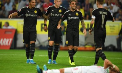 COLOGNE, GERMANY - AUGUST 23: Paco Alcacer of Borussia Dortmund (2R) celebrates with his team mates after scoring his side's third goal during the Bundesliga match between 1. FC Koeln and Borussia Dortmund at RheinEnergieStadion on August 23, 2019 in Cologne, Germany. (Photo by Matthias Hangst/Bongarts/Getty Images)