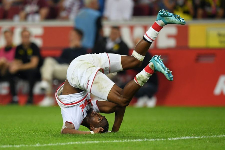 COLOGNE, GERMANY - AUGUST 23: Kingsley Ehizibue of 1. FC Koeln tumbles over during the Bundesliga match between 1. FC Koeln and Borussia Dortmund at RheinEnergieStadion on August 23, 2019 in Cologne, Germany. (Photo by Matthias Hangst/Bongarts/Getty Images)