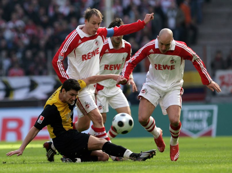 COLOGNE, GERMANY - MARCH 23: Enis Alushi of Wehen (L), Kevin McKenna (M) and his team mate Nemanja Vucicevic of Koeln battle for the ball during the second Bundesliga match between 1. FC Koeln and SV Wehen-Wiesbaden at the RheinEnergie stadium on March 23, 2008 in Cologne, Germany. (Photo by Vladimir Rys/Bongarts/Getty Images)