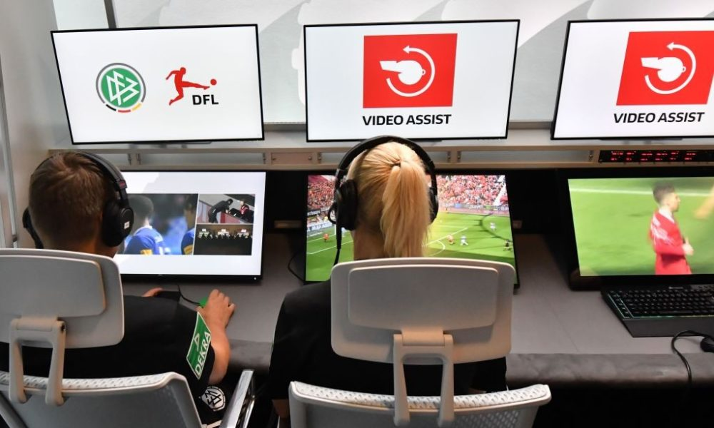 """Bundesliga Referee Bibiana Steinhaus (R) and referee Thorben Siewer (L) sit at the Video Assist Center (VAC) during the Media Workshop """"Video Assistant"""" at the Cologne Broadcasting Center in Cologne, western Germany, on August 05, 2019. (Photo by INA FASSBENDER / AFP) (Photo credit should read INA FASSBENDER/AFP/Getty Images)"""