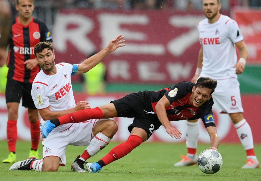 WIESBADEN, GERMANY - AUGUST 11: Jeremias Lorch of SV Wehen Wiesbaden is challenged by Jonas Hector of 1. FC Koeln during the DFB Cup first round match between SV Wehen Wiesbaden and 1. FC Koeln at BRITA-Arena on August 11, 2019 in Wiesbaden, Germany. (Photo by Matthias Hangst/Bongarts/Getty Images)