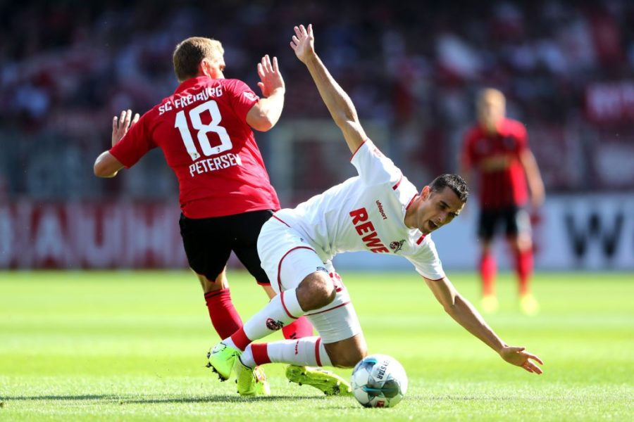 FREIBURG IM BREISGAU, GERMANY - AUGUST 31: Ellyes Skhiri of 1. FC Koln battles for possession with Nils Petersen of Sport-Club Freiburg during the Bundesliga match between Sport-Club Freiburg and 1. FC Koeln at Schwarzwald-Stadion on August 31, 2019 in Freiburg im Breisgau, Germany. (Photo by Simon Hofmann/Bongarts/Getty Images)