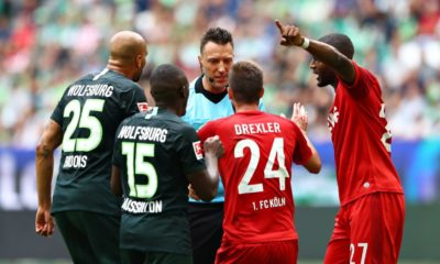 WOLFSBURG, GERMANY - AUGUST 17: Referee Sven Jablonski talks with players of VfL Wolfsburg and 1. FC Koeln during the Bundesliga match between VfL Wolfsburg and 1. FC Koeln at Volkswagen Arena on August 17, 2019 in Wolfsburg, Germany. (Photo by Martin Rose/Bongarts/Getty Images)