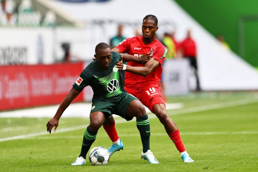 WOLFSBURG, GERMANY - AUGUST 17: Jerome Roussillon of VfL Wolfsburg is challenged by Kingsley Ehizibue of 1. FC Koln during the Bundesliga match between VfL Wolfsburg and 1. FC Koeln at Volkswagen Arena on August 17, 2019 in Wolfsburg, Germany. (Photo by Martin Rose/Bongarts/Getty Images)