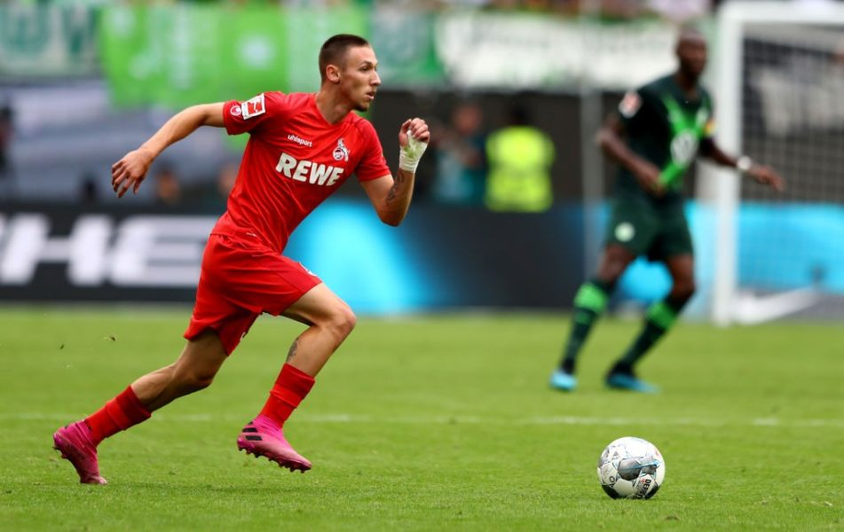 WOLFSBURG, GERMANY - AUGUST 17: Darko Churlinov of Koeln runs with the ball during the Bundesliga match between VfL Wolfsburg and 1. FC Koeln at Volkswagen Arena on August 17, 2019 in Wolfsburg, Germany. (Photo by Martin Rose/Bongarts/Getty Images)