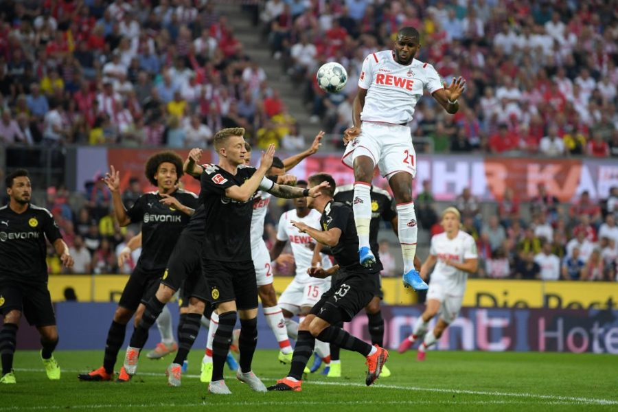 COLOGNE, GERMANY - AUGUST 23: Anthony Modeste of 1. FC Koeln rises to head the ball during the Bundesliga match between 1. FC Koeln and Borussia Dortmund at RheinEnergieStadion on August 23, 2019 in Cologne, Germany. (Photo by Matthias Hangst/Bongarts/Getty Images)