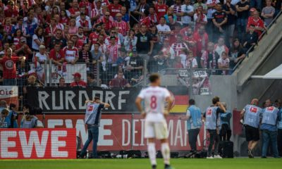 COLOGNE, GERMANY - SEPTEMBER 14: A fire cracker is thrown pitchside during the Bundesliga match between 1. FC Koeln and Borussia Moenchengladbach at RheinEnergieStadion on September 14, 2019 in Cologne, Germany. (Photo by Jörg Schüler/Bongarts/Getty Images)