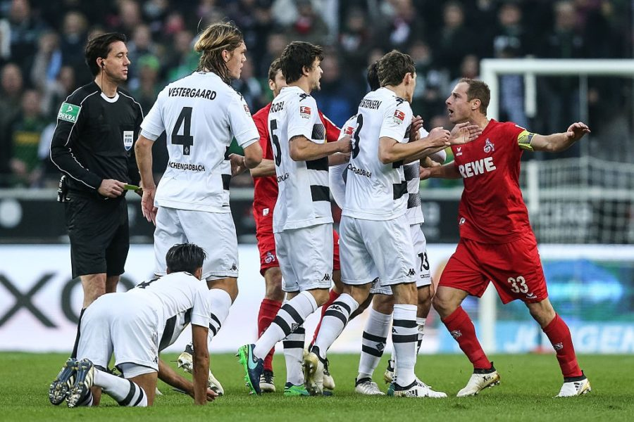 MOENCHENGLADBACH, GERMANY - NOVEMBER 19: Matthias Lehmann (R) of Koeln and Team of Moenchengladbach argue during the Bundesliga match between Borussia Moenchengladbach and 1. FC Koeln at Borussia-Park on November 19, 2016 in Moenchengladbach, Germany. (Photo by Maja Hitij/Bongarts/Getty Images)