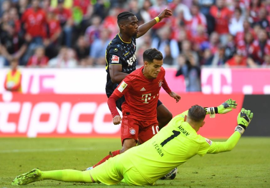 Cologne's Dutch defender Kingsley Ehizibue (L) attacks Bayern Munich's Brazilian midfielder Philippe Coutinho (C) as Cologne's German goalkeeper Timo Horn (R) dives for the ball during the German First division Bundesliga football match between FC Bayern Munich and 1 FC Cologne in Munich, on September 21, 2019. (Photo by Christof STACHE / AFP) / DFL REGULATIONS PROHIBIT ANY USE OF PHOTOGRAPHS AS IMAGE SEQUENCES AND/OR QUASI-VIDEO (Photo credit should read CHRISTOF STACHE/AFP/Getty Images)