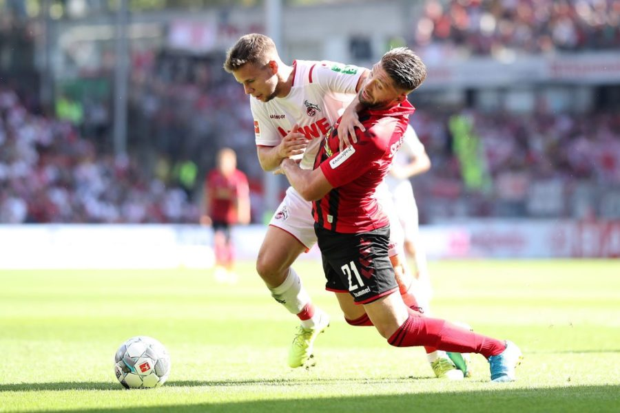 FREIBURG IM BREISGAU, GERMANY - AUGUST 31: Brandon Borrello of Sport-Club Freiburg is challenged by Louis Schaub of 1. FC Koln during the Bundesliga match between Sport-Club Freiburg and 1. FC Koeln at Schwarzwald-Stadion on August 31, 2019 in Freiburg im Breisgau, Germany. (Photo by Simon Hofmann/Bongarts/Getty Images)